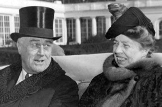 Former President Franklin Delano Roosevelt and wife, Eleanor, riding together.