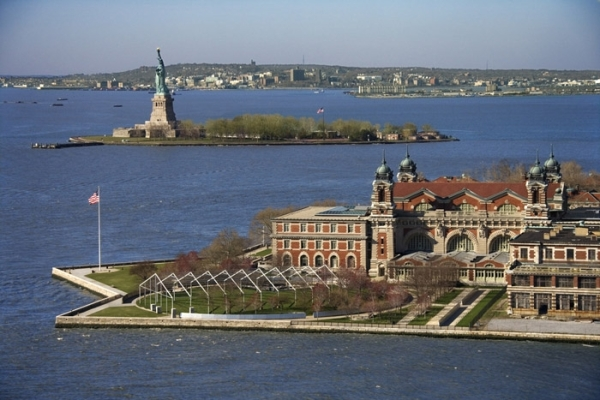 View of Ellis Island with Liberty island in the background.