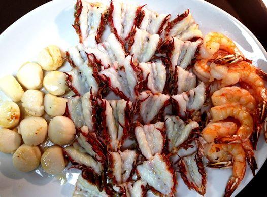 Scallops, rock shrimp, and pink shrimp. The rock shrimp tastes like lobster, only juicer.
