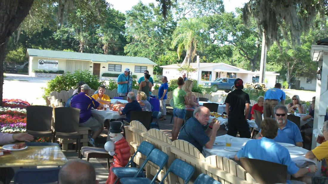 You can dine outside under the live oaks.